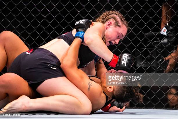 Aspen Ladd lands blows against Sijara Eubanks during round two of a bantamweight bout at Blue Cross Arena on May 18 2019 in Rochester New York Ladd...
