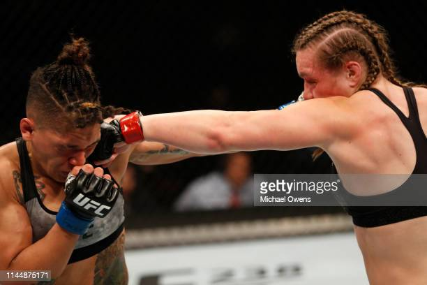 Aspen Ladd punches Sijara Eubanks in their women's bantamweight bout during the UFC Fight Night event at Blue Cross Arena on May 18 2019 in Rochester...