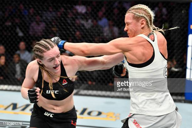Aspen Ladd punches Yana Kunitskaya of Russia in their women's bantamweight bout during the UFC Fight Night event at Capital One Arena on December 07...