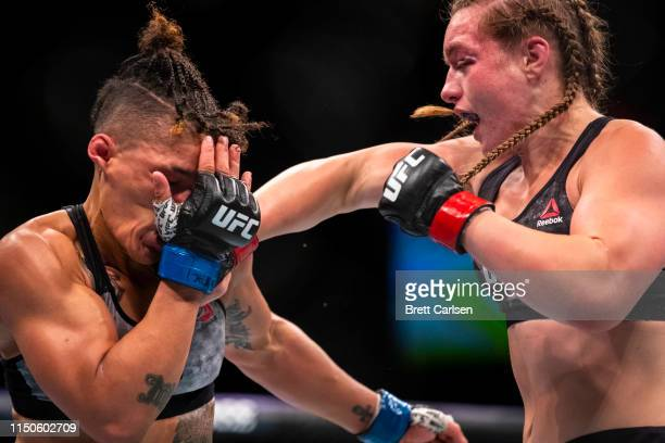 Aspen Ladd sneaks a punch behind the guard of Sijara Eubanks during round three of a bantamweight bout at Blue Cross Arena on May 18 2019 in...