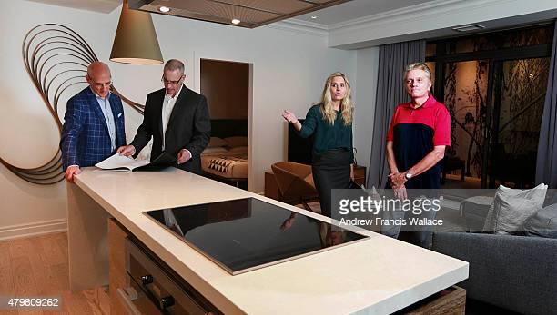 Aspen sales representatives Richard Schmidt and Michelle Jalservae pose with CHUM-FM morning man Roger Ashby and Quadrangle Architects Les Klein ,...