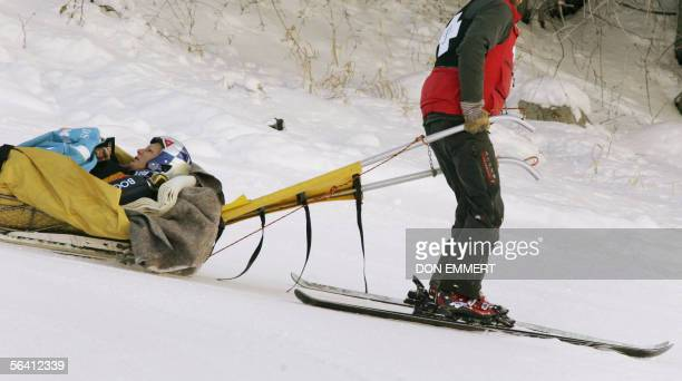 Maria Riesch of Germany is taken off the course by the ski patrol after skiing off course in the World Cup women's giant slalom 10 December 2005 in...