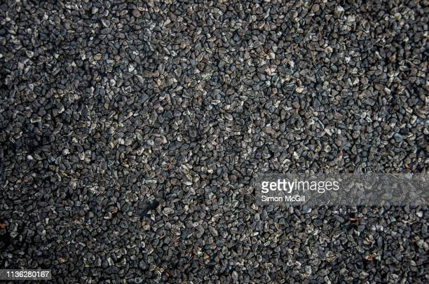 asphalt and gravel road surface - gravel stock pictures, royalty-free photos & images