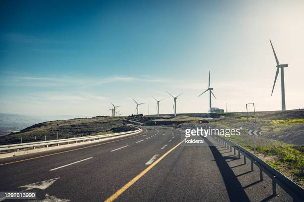 asphalt highway with wind turbines - israel stock pictures, royalty-free photos & images