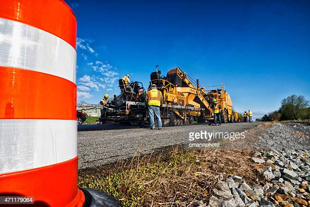 Asphalt paving machinery  resurfacing an old worn road
