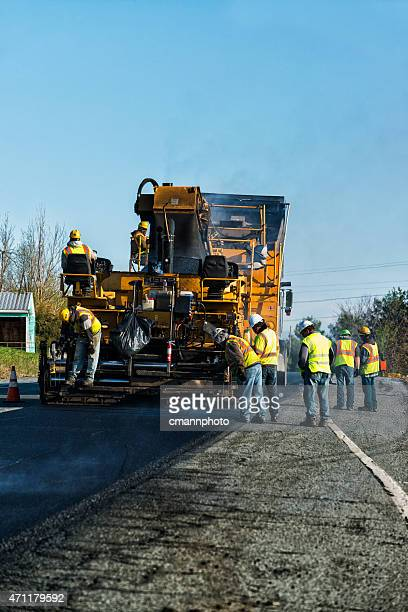 asphalt paving machinery  resurfacing an old worn road - asphalt paving stock photos and pictures