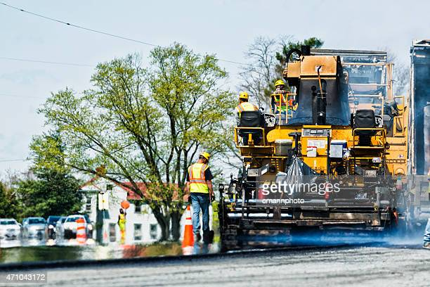 asphalt re-surfacing of a worn road - asphalt paving stock photos and pictures