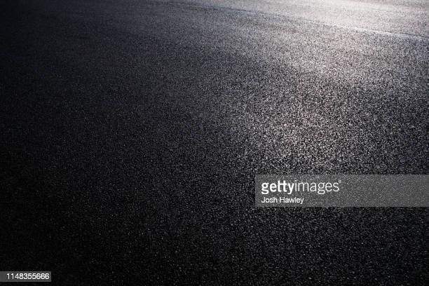 asphalt road backgrounds - grainy stock pictures, royalty-free photos & images