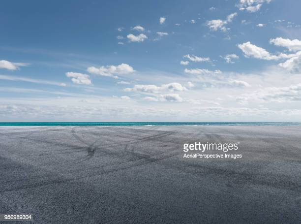 asphalt road in front of sea - day stock pictures, royalty-free photos & images