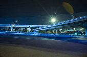 Asphalt road in motion blur in the Xizhimen Junction in Beijing City at night