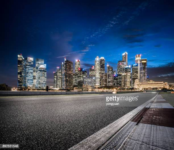 asphalt road in singapore at night - night stock pictures, royalty-free photos & images