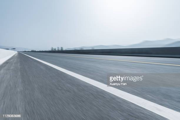 asphalt road - dividing line road marking stock pictures, royalty-free photos & images