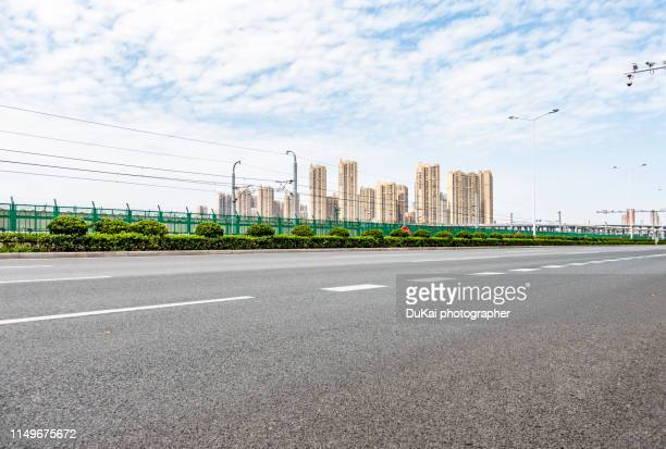asphalt road - avenue stock pictures, royalty-free photos & images