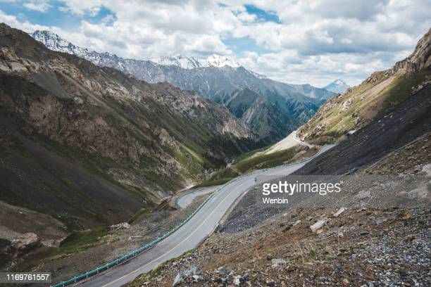 asphalt road - tien shan mountains stock pictures, royalty-free photos & images