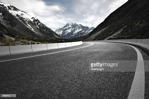 Asphalt road with snow mountain background.