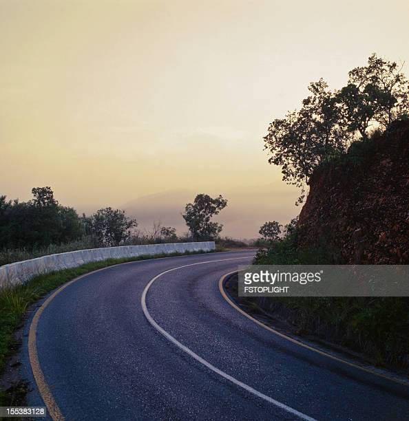 asphalt rural road with dusk - fstoplight stock photos and pictures