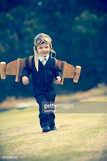 Aspiration, innovation business concept. Young child wearing hom