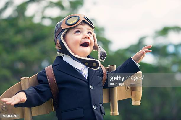 aspiration, innovation business concept. young child wearing hom - joy stock pictures, royalty-free photos & images