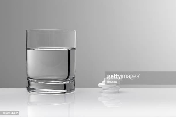 aspirin paracetamol pill and glass of water - acetaminophen stock photos and pictures