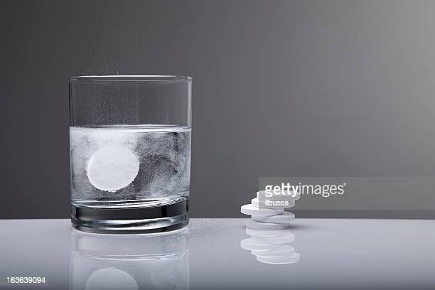 aspirin paracetamol pill splashing into glass of water - acetaminophen stock photos and pictures