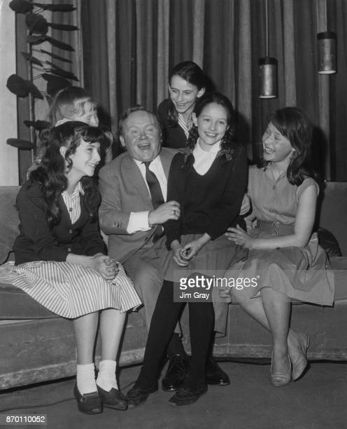 Aspiring actress Olivia Hussey sits on the knee of English actor and comedian Charlie Drake during an audition June 1963 She recited the poem 'The...