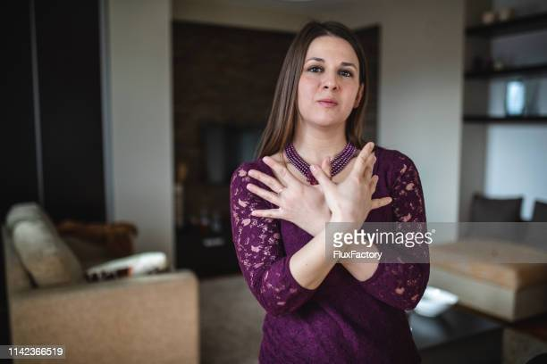 aspiring deaf woman gesturing in sign language butterfly - serbian - sign language stock pictures, royalty-free photos & images