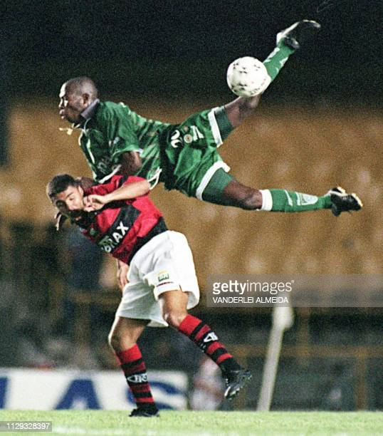 Asprilla of team Palmeiras crashes into V of team Flamengo 16 December during the first of two games in the final of the Copa MERCOSUR at Maracana...