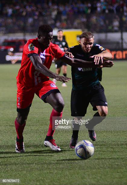 Ass Mandaw Sy of FUS RabatYoucef Grey Laid Touati of MO Bejaia go headtohead in the first leg of the 2016 Caf Confederation Cup semifinal at the...