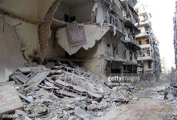 Assad regime forces barrel bomb air strike at Sukkari of Aleppo destroys many buildings including a mosque on March 8 2014