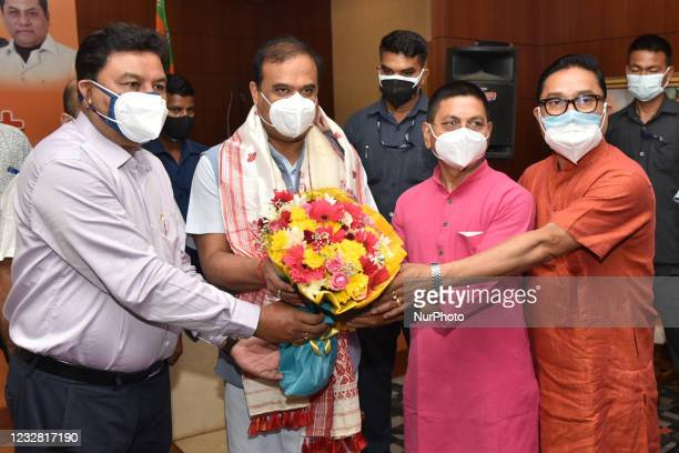 Assam Chief Minister Himanta Biswa Sarma being felicitated by State BJP President Ranjit Kumar and MP Dilip Saikia at the party office, Hengrabari,...