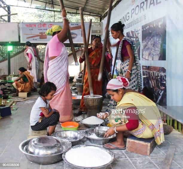 PANJABARI GUWAHATI ASSAM INDIA Assamese women preparing traditional Assamese cake ahead of Bhogali Bihu to mark the end of winter harvesting festival