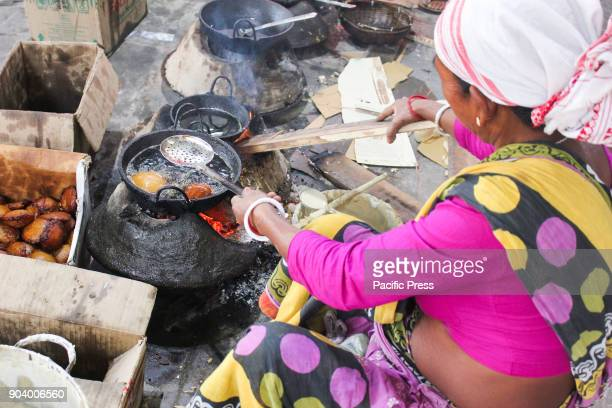PANJABARI GUWAHATI ASSAM INDIA Assamese women preparing traditional Assamese cake ahead of Bhogali Bihu to mark the end of winter harvesting festival