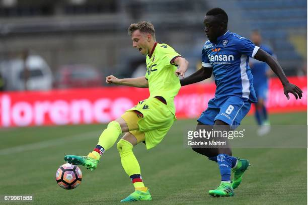 Assane Diousse' of Empoli FC battles for the ball with Ladislav Krejci of Bologna FC during the Serie A match between Empoli FC and Bologna FC at...