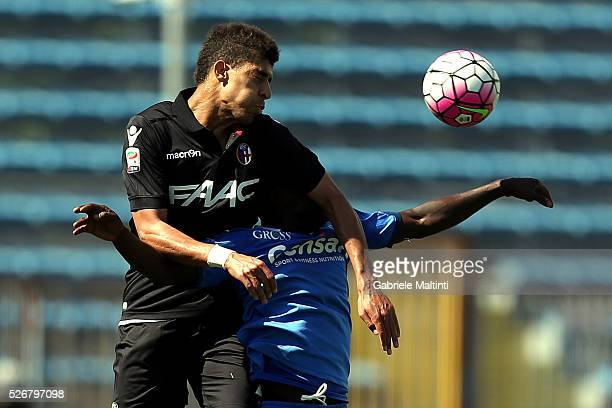 Assane Doiusse of Empoli FC battles for the ball with Adam Masina of Bologna Fc during the Serie A match between Empoli FC and Bologna FC at Stadio...