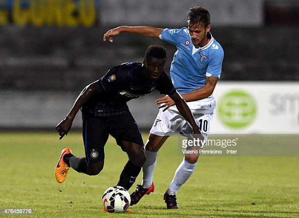 Assane Gnoukouri of FC Internazionale Milano Juvenile is challenged by Alessandro Murgia of SS Lazio Juvenile during the Juvenile Playoffs match...