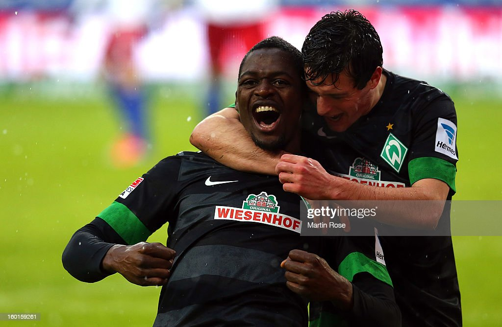 Assani Lukimya (L of Bremenceleb rates after he scores his team's 1st goal during the Bundesliga match between Hamburger SV and SV Werder Bremen at Imtech Arena on January 27, 2013 in Hamburg, Germany.