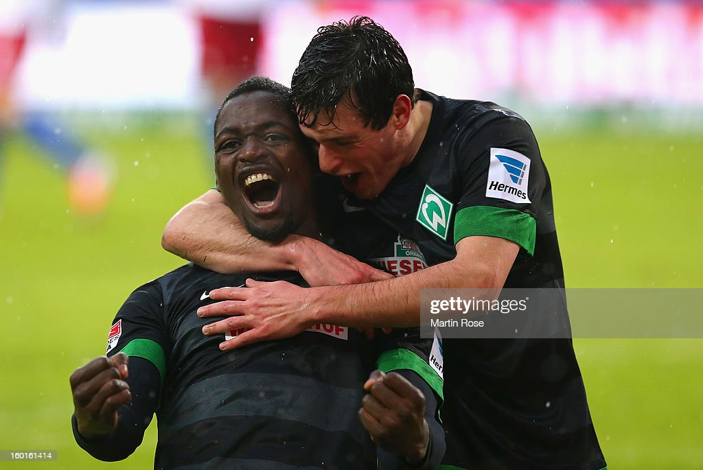 Assani Lukimya (C) of Bremen celebrates after he heads his team's 1st goal during the Bundesliga match between Hamburger SV and SV Werder Bremen at Imtech Arena on January 27, 2013 in Hamburg, Germany.