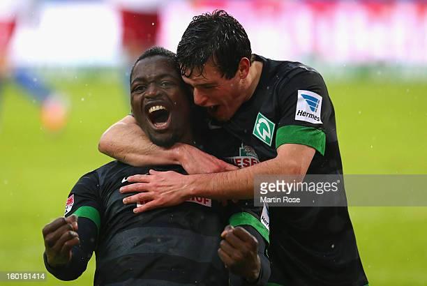 Assani Lukimya of Bremen celebrates after he heads his team's 1st goal during the Bundesliga match between Hamburger SV and SV Werder Bremen at...
