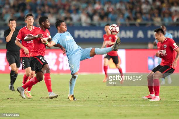 Assani Lukimya of Liaoning Whowin and Roger Martinez of Jiangsu Suning compete for the ball during the 18th round match of 2017 Chinese Football...