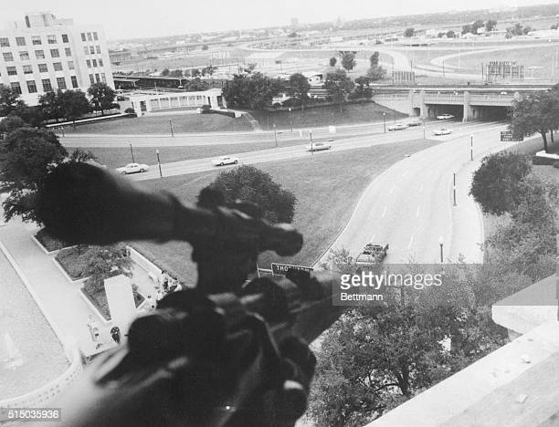 Assassin'sEyeView Dallas This is an assassin'seyeview of an automobile like the one carrying John Kennedy driven by a Dallas policeman with a...