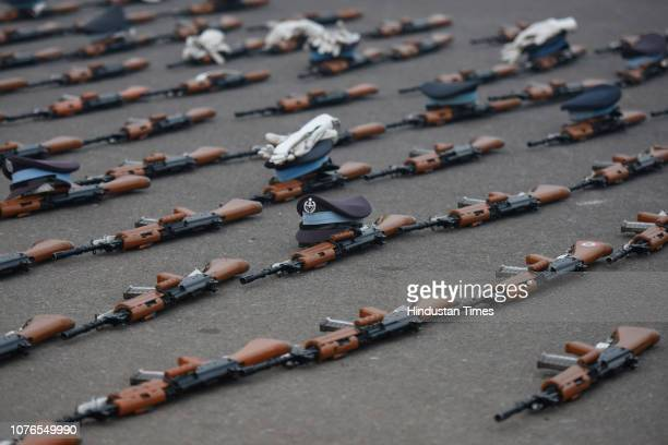 INSAS assault rifles are seen laid out while Indian Air Force personnel take break following rehearsal for the upcoming Republic Day parade at Vijay...