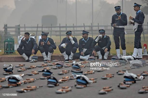 INSAS assault rifles seen laid out while Indian Air Force personnel take a snack break following rehearsal for the upcoming Republic Day parade at...