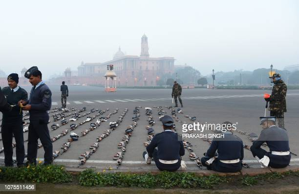 INSAS assault rifles the standard infantry weapon in the Indian armed forces are seen laid out while Indian Air Force personnel enjoy a snacks break...