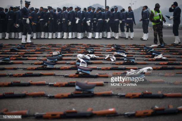 TOPSHOT INSAS assault rifles the standard infantry weapon in the Indian armed forces are seen laid out while Indian Air Force personnel enjoy a snack...