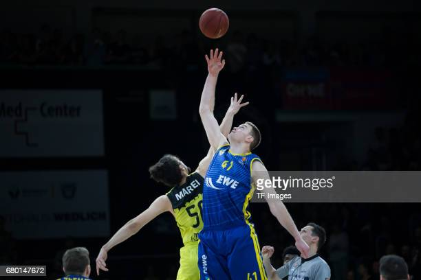 Assem Marei of medi bayreuth and Brian Qvale of EWE Baskets Oldenburg battle for the ball during the easyCredit BBL match between medi bayreuth and...