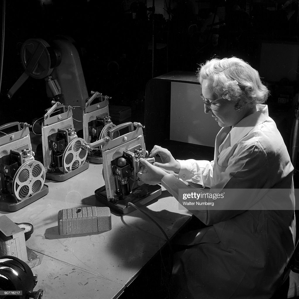 Female worker assembles8mm cine projectors, Mitcheldean, 1956. : News Photo