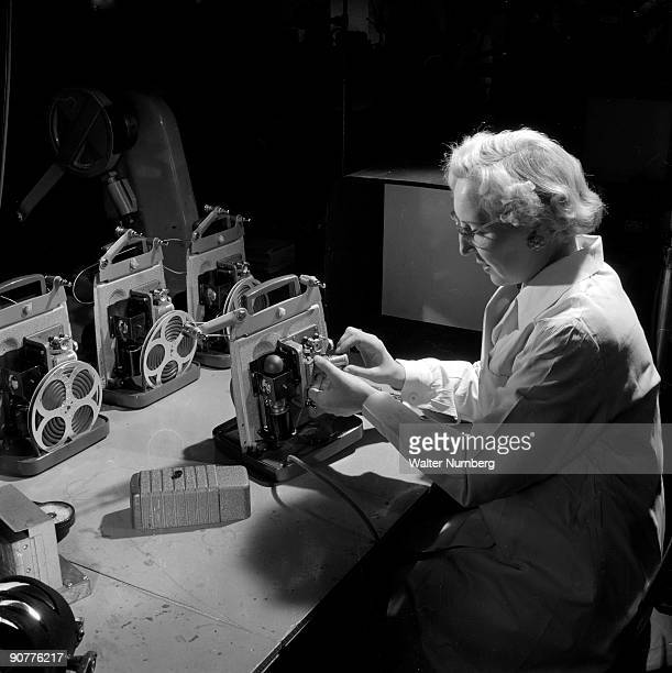 Assembling an 8mm cine projector at the factory of British Acoustic Films The Surrey based company thrived during the 1950s boom in amateur cine...
