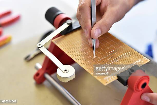 assembling of a circuit board - mechatronics stock pictures, royalty-free photos & images