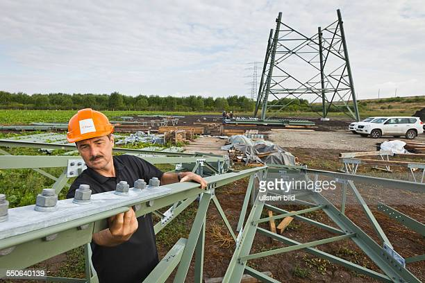 Assembling of transmission towers for the transmission system operator 50Hertz Controller Andreas Noeckel checks the fasteners on cross arms the stub...