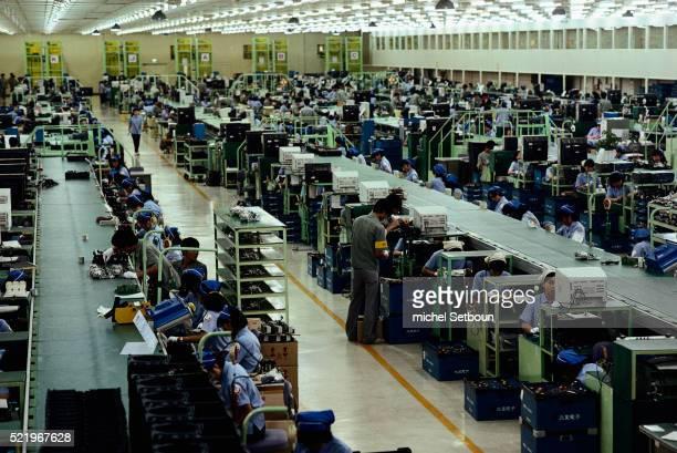 Assembling VCRs at Samsung Electronics Plant